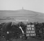 SD950299B, Man marking Ordnance Survey minor control revision point with an arrow in 1950s