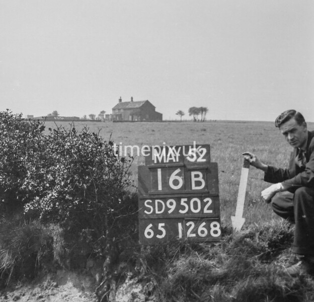 SD950216B, Man marking Ordnance Survey minor control revision point with an arrow in 1950s