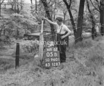 SD960105B, Man marking Ordnance Survey minor control revision point with an arrow in 1950s