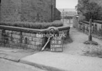 SD980191B, Man marking Ordnance Survey minor control revision point with an arrow in 1950s