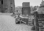 SD970199A, Man marking Ordnance Survey minor control revision point with an arrow in 1950s