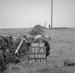 SD960212A, Man marking Ordnance Survey minor control revision point with an arrow in 1950s