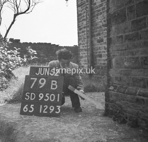 SD950179B, Man marking Ordnance Survey minor control revision point with an arrow in 1950s
