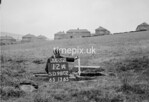 SD980212A, Man marking Ordnance Survey minor control revision point with an arrow in 1950s