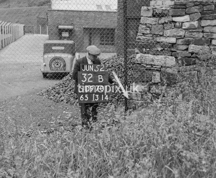 SD970132B, Man marking Ordnance Survey minor control revision point with an arrow in 1950s