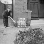 SD950067B, Man marking Ordnance Survey minor control revision point with an arrow in 1950s