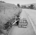 SD960015B, Man marking Ordnance Survey minor control revision point with an arrow in 1950s