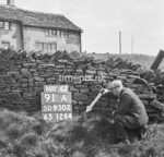 SD950291A, Man marking Ordnance Survey minor control revision point with an arrow in 1950s