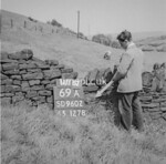 SD960269A, Man marking Ordnance Survey minor control revision point with an arrow in 1950s