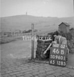 SD960146B, Man marking Ordnance Survey minor control revision point with an arrow in 1950s