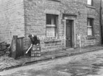 SD970201A, Man marking Ordnance Survey minor control revision point with an arrow in 1950s