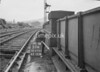 SD970151A, Man marking Ordnance Survey minor control revision point with an arrow in 1950s