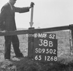 SD950238B, Man marking Ordnance Survey minor control revision point with an arrow in 1950s