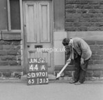 SD970144A, Man marking Ordnance Survey minor control revision point with an arrow in 1950s