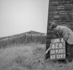 SD950162B, Man marking Ordnance Survey minor control revision point with an arrow in 1950s