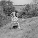 SD950146B, Man marking Ordnance Survey minor control revision point with an arrow in 1950s