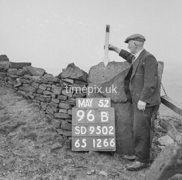 SD950296B, Man marking Ordnance Survey minor control revision point with an arrow in 1950s