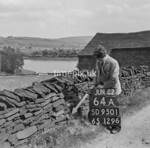 SD950164A, Man marking Ordnance Survey minor control revision point with an arrow in 1950s