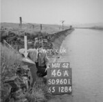 SD960146A, Man marking Ordnance Survey minor control revision point with an arrow in 1950s