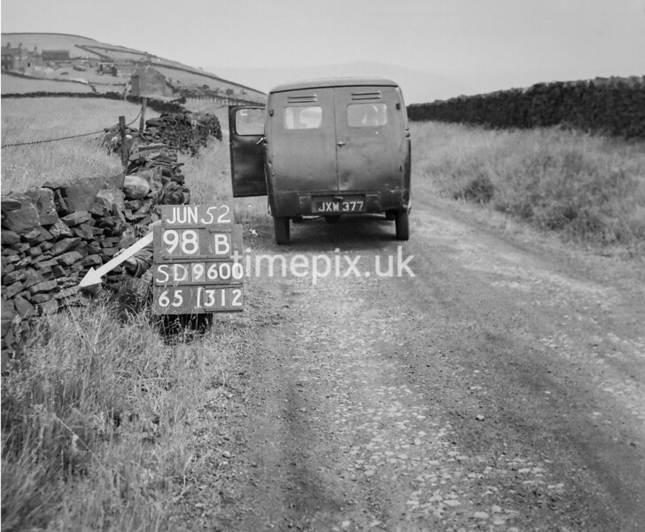 SD960098B, Man marking Ordnance Survey minor control revision point with an arrow in 1950s