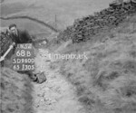 SD960068B, Man marking Ordnance Survey minor control revision point with an arrow in 1950s