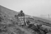 SD980278A, Man marking Ordnance Survey minor control revision point with an arrow in 1950s