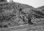 SD970141B, Man marking Ordnance Survey minor control revision point with an arrow in 1950s
