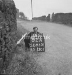 SD960182A, Man marking Ordnance Survey minor control revision point with an arrow in 1950s