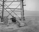 SD960021A, Man marking Ordnance Survey minor control revision point with an arrow in 1950s
