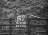 SD970029B, Man marking Ordnance Survey minor control revision point with an arrow in 1950s