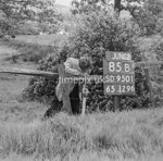 SD950185B, Man marking Ordnance Survey minor control revision point with an arrow in 1950s