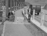 SD970142A, Man marking Ordnance Survey minor control revision point with an arrow in 1950s