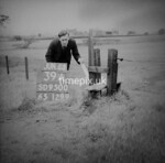 SD950039A, Man marking Ordnance Survey minor control revision point with an arrow in 1950s