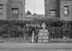 SD970282B, Man marking Ordnance Survey minor control revision point with an arrow in 1950s