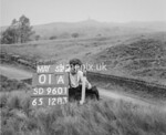 SD960101A, Man marking Ordnance Survey minor control revision point with an arrow in 1950s