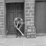 SD970148B, Man marking Ordnance Survey minor control revision point with an arrow in 1950s