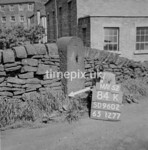 SD960284K, Man marking Ordnance Survey minor control revision point with an arrow in 1950s