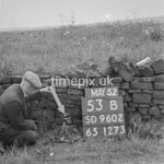 SD960253B, Man marking Ordnance Survey minor control revision point with an arrow in 1950s