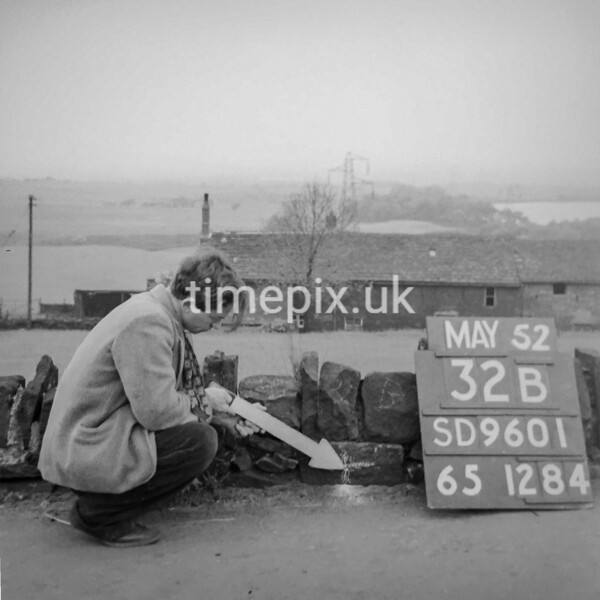SD960132B, Man marking Ordnance Survey minor control revision point with an arrow in 1950s