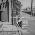 SD960275B, Man marking Ordnance Survey minor control revision point with an arrow in 1950s