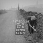 SD960227B, Man marking Ordnance Survey minor control revision point with an arrow in 1950s