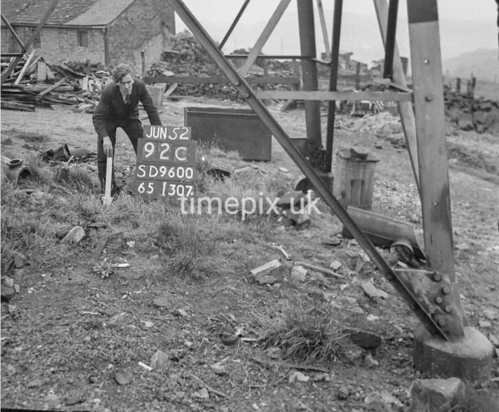 SD960092C, Man marking Ordnance Survey minor control revision point with an arrow in 1950s