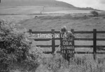 SD980208A, Man marking Ordnance Survey minor control revision point with an arrow in 1950s