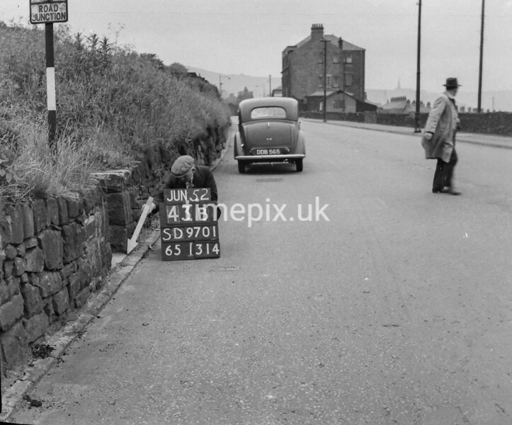 SD970143B, Man marking Ordnance Survey minor control revision point with an arrow in 1950s