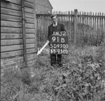 SD950091B, Man marking Ordnance Survey minor control revision point with an arrow in 1950s