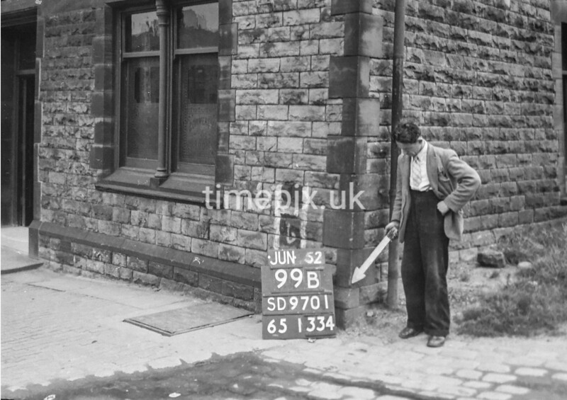 SD970199B, Man marking Ordnance Survey minor control revision point with an arrow in 1950s