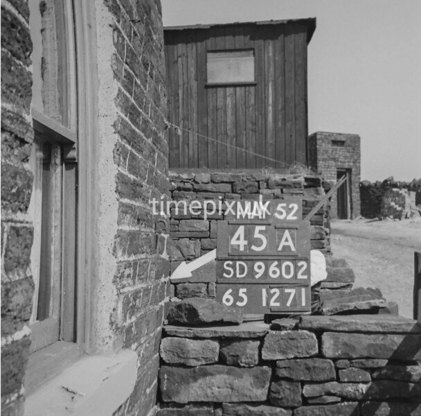 SD960245A, Man marking Ordnance Survey minor control revision point with an arrow in 1950s