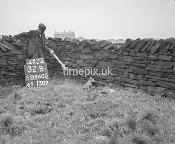 SD960032B, Man marking Ordnance Survey minor control revision point with an arrow in 1950s