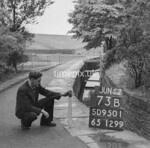 SD950173B, Man marking Ordnance Survey minor control revision point with an arrow in 1950s