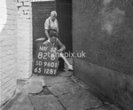 SD960182B, Man marking Ordnance Survey minor control revision point with an arrow in 1950s